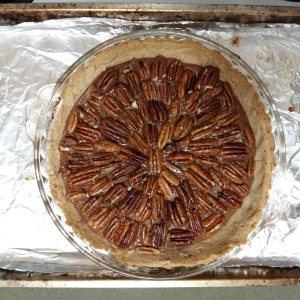Overhead view of homemade pecan pie in glass dish